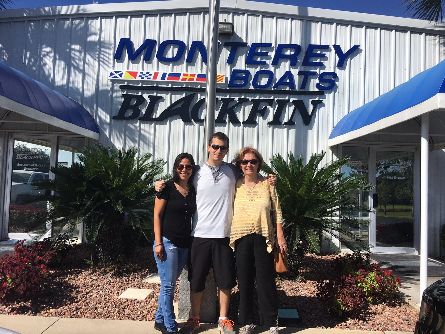"""Derek and family – soon to be new M65 owners!"" Thunder Marine St. Pete, Florida"